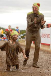 Bob in his frog outfit at the Mini Muddy Buddy Austin event with double above knee amputee Cody McCasland.